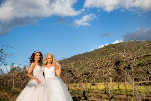 gay couple bridal portraits in the grapevines at Stonehurst weddings