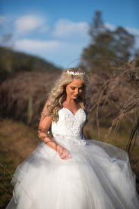 laughing bridal portrait in the grapevines at Stonehurst weddings
