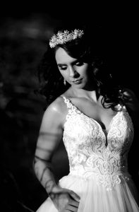 dark and moody bridal portrait with sun flair at Stonehurst weddings