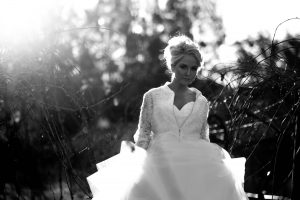 black and white bridal portrait with sun flair at Stonehurst Cedar Creek
