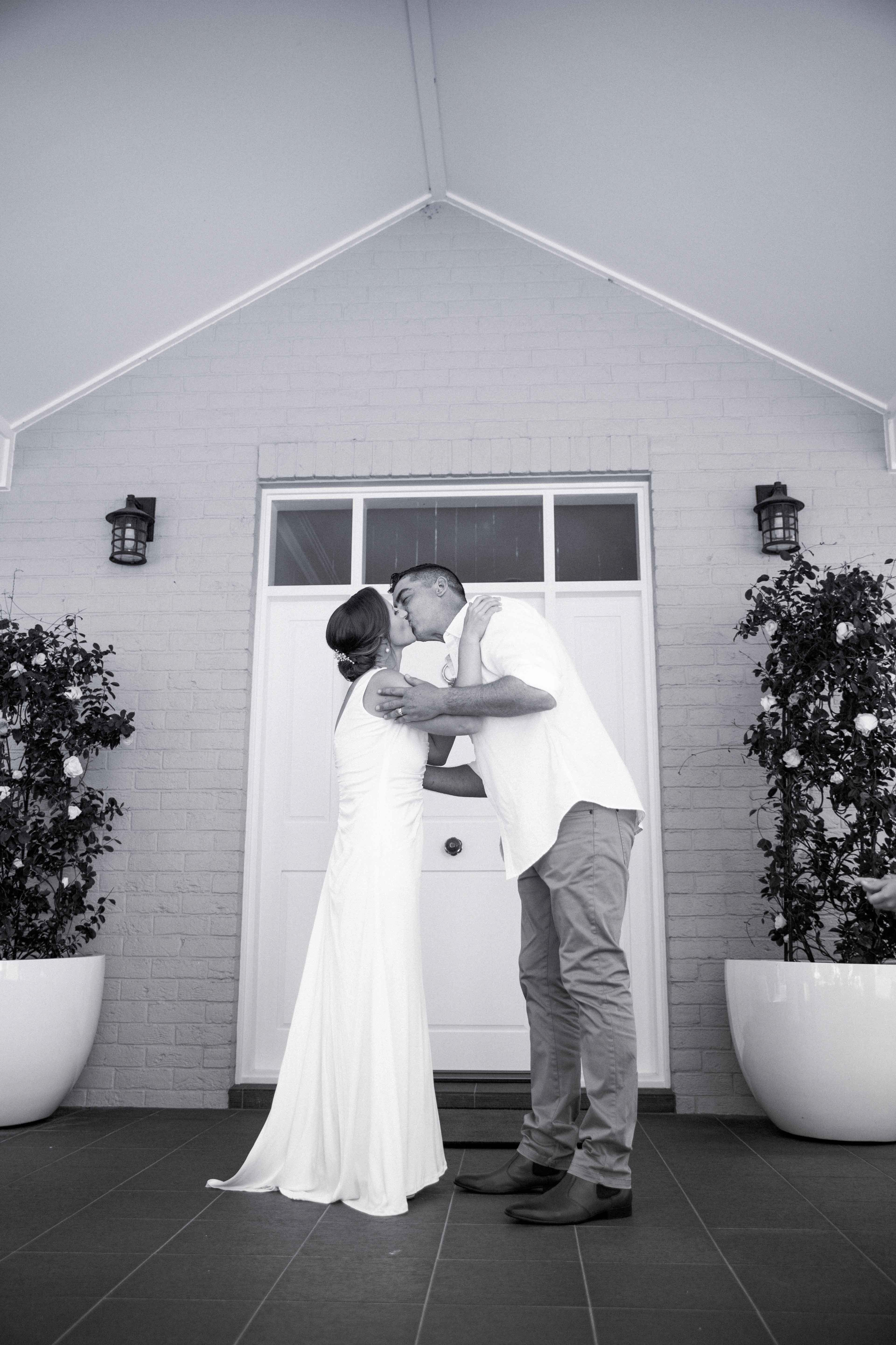Newly married kisses at the alter at whitebridge, NSW