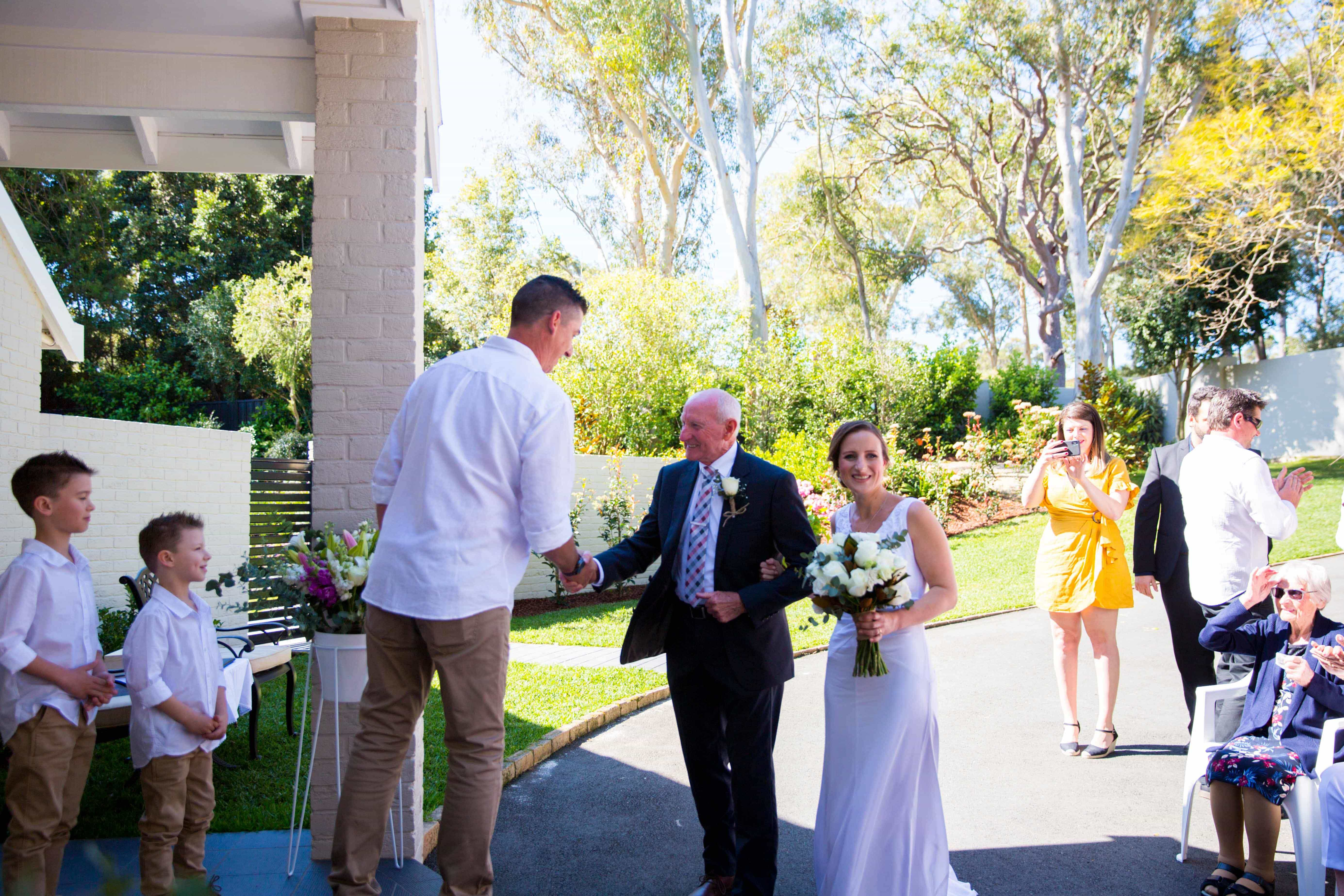 walking down the aisle Marriage ceremony with bride and groom at Whitebridge NSW