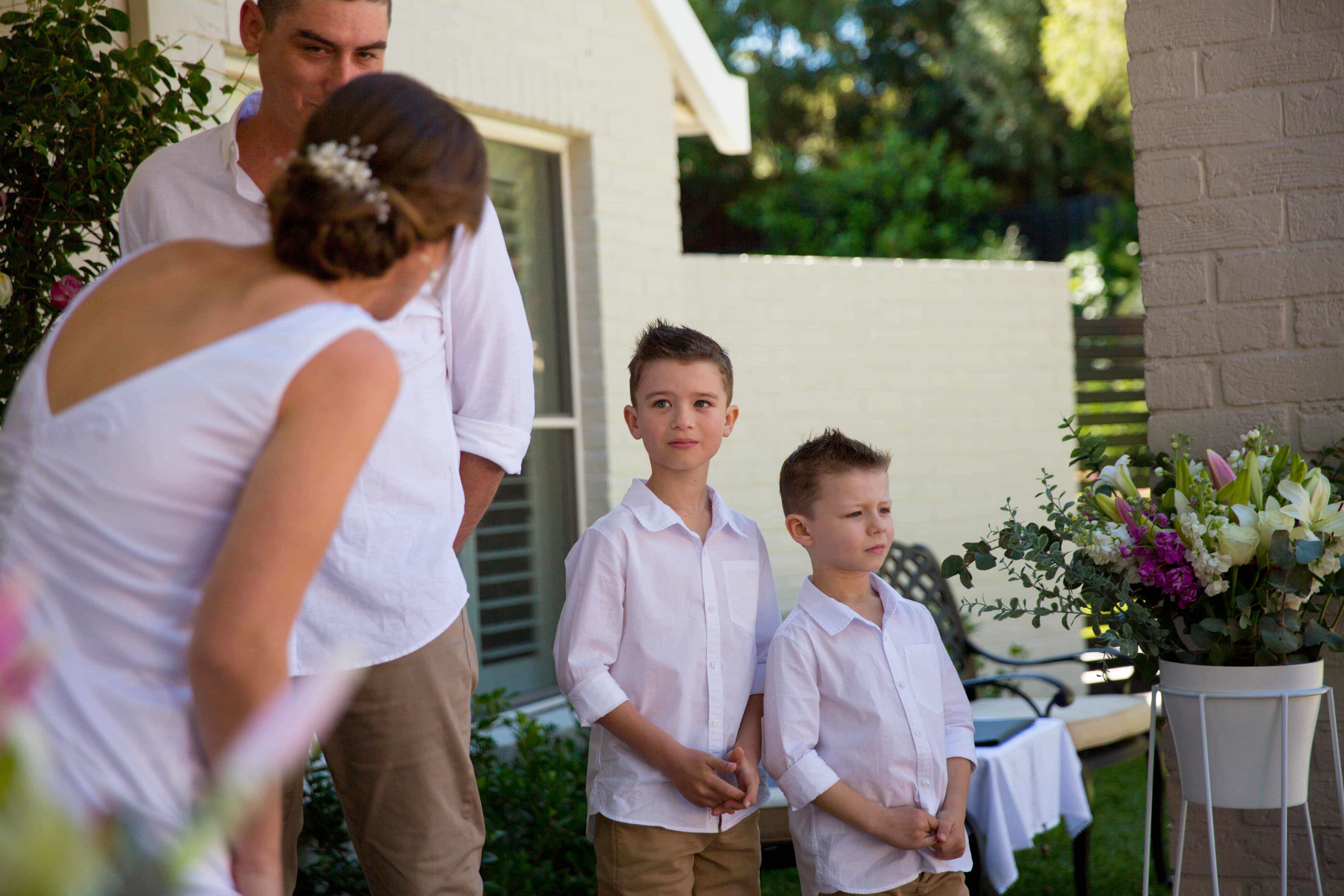 Marriage ceremony with 2 kids smiling at the alter at Whitebridge NSW