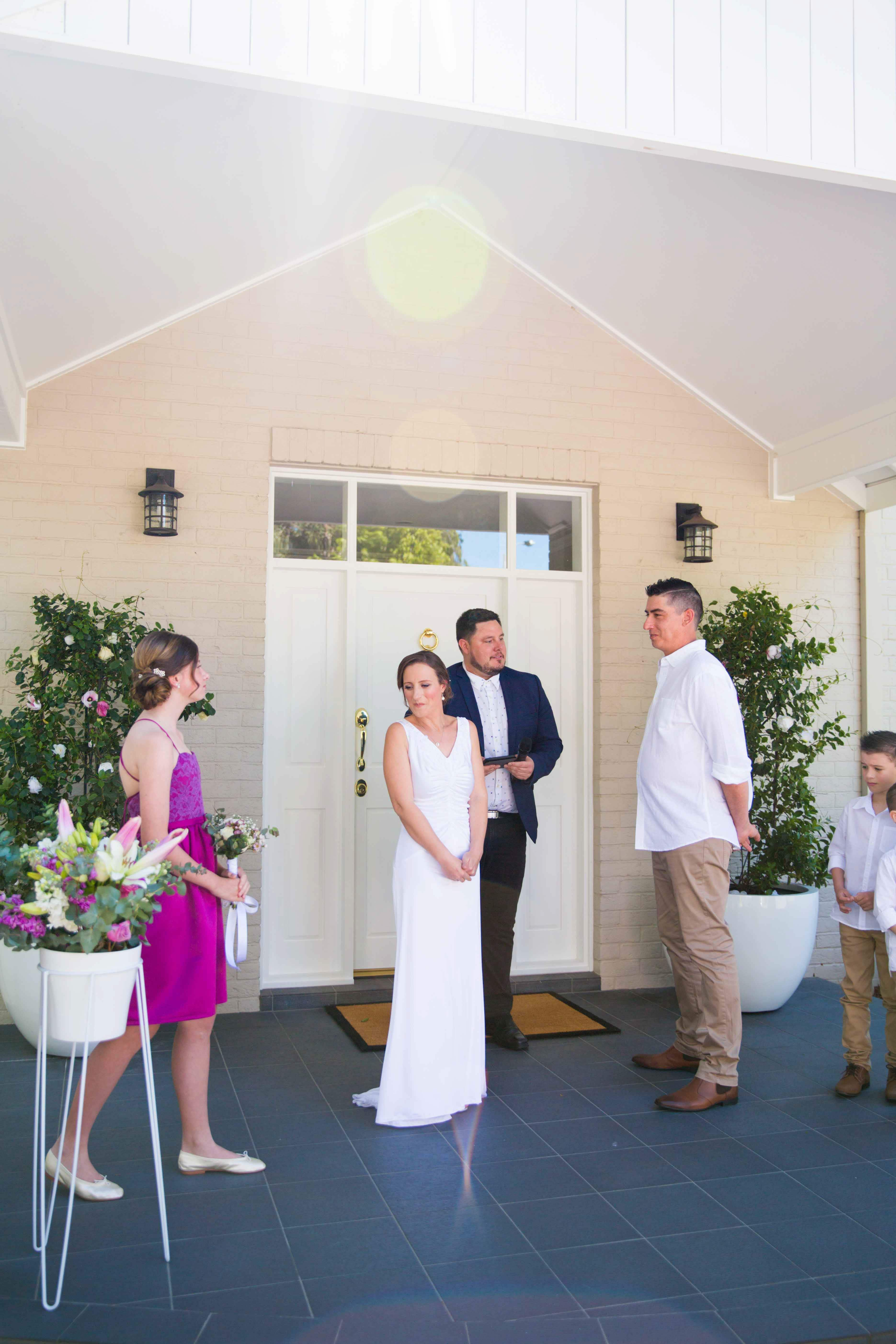 Marriage ceremony with bride and groom at the alter at Whitebridge NSW