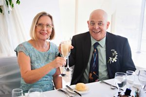 Clinking glasses at recpetion at noahs on the beach Newcastle wedding venue