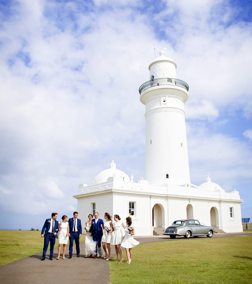 Wedding bridal party next to lighthouse